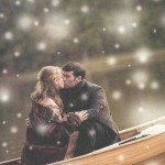Holiday 2010 Brochure - Mucklows Fine Jewelry, A couple in a canoe kissing in winter